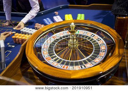 Wooden Roulette Table In Casino Chips