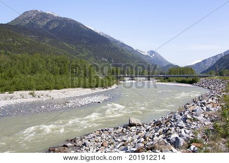 The view of Skagway town bridge over Skagway River and AB Mountain and the background (Alaska).