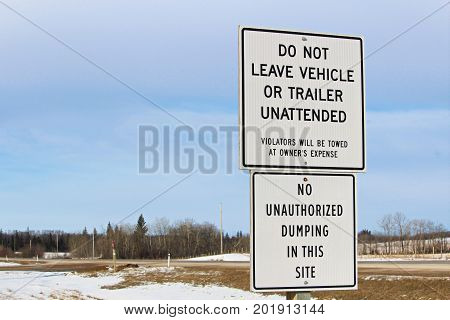No Unattended Vehicles Or Dumping Sign Along A Highway