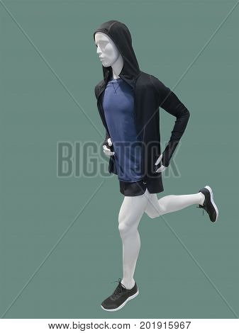 Running male mannequin isolated on green background. No brand names or copyright objects.