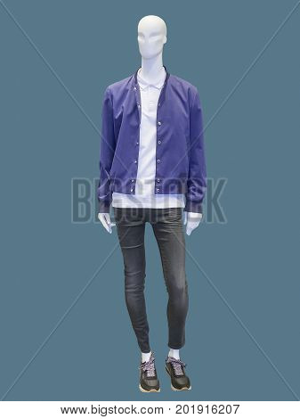 Full length male mannequin dressed in blue jacket and black jeans isolated. No brand names or copyright objects.