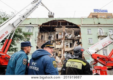 Orel Russia August 29 2017: Collapse of old apartment house. Elevating cranes on fire trucks and EMERCOM team works in place of catastrope horizontal