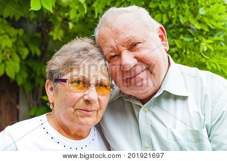 Happy senior couple in love posing in the park outdoor