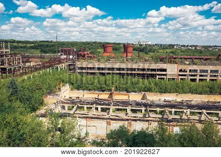 Panoramic aerial view from above to Soviet abandoned factory in Efremov, Russia. Abandoned buildings, workshops overgrown with green forest