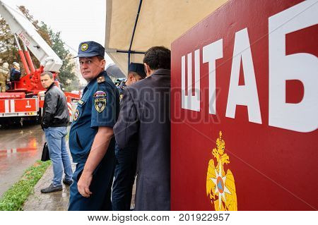 Orel Russia August 29 2017: Collapse of old apartment house. EMERCOM Emergency control officer at red Headquarters wall looking at camera