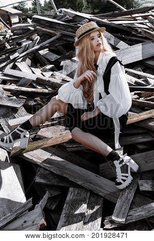 Fashion Young Woman Wearing Stylish Dress And Straw Hat At Countryside. Amish Fashion Style.