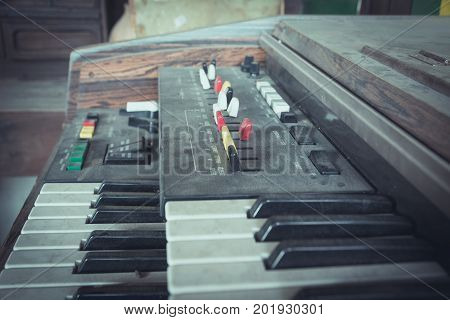 Close up keys of the old synthesizer keyboard. close-up electric piano.