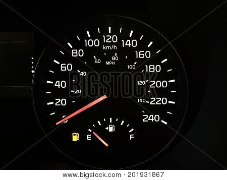 A Speedometer Showing An Empty Fuel Tank Light