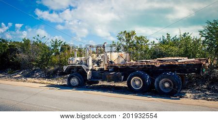 Derelict  abandon truck on the side of the road Turks and Caicos