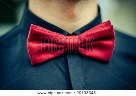 groomsman in blue shirt and red bow tie