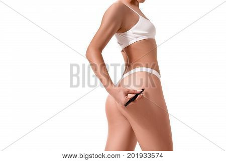 Healthy lifestyle diet and fitness. Beautiful slim woman's body. Perfect slim toned young body of the girl. Fitness or plastic surgery and aesthetic cosmetology. Taut elastic ass. Firm buttocks