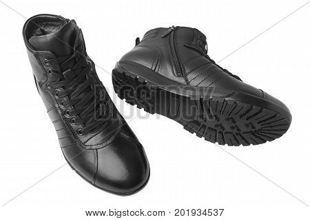 Men's leather short boots isolated on white background. Winter boots