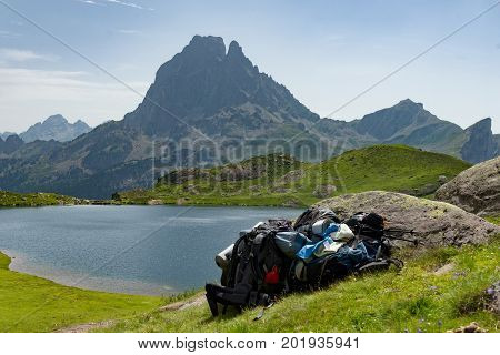 View of mountain the Pic du Midi d'Ossau in the French Pyrenees with backpacks
