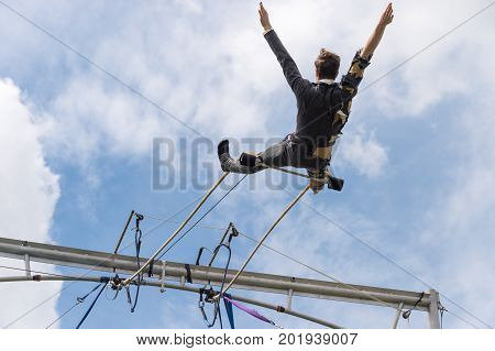 Trapeze Artist Performing Outside