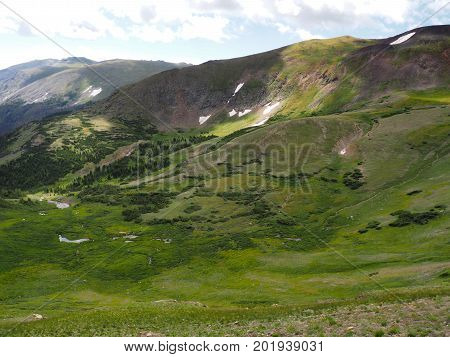 The highest point in the Rocky Mountains National Park in Colorado. The tundra has still even though it is summer.