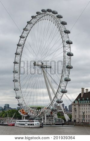 LONDON ENGLAND - JUNE 08 2017: View at London Eye Millennium Wheel at South Bank of river Thames in London England