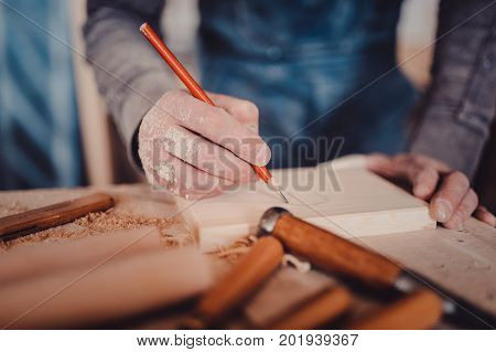 Carpenter Marking Position On Wood