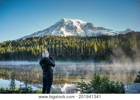 The Woman Photographer Taking Pictures Of Mountain And Lake