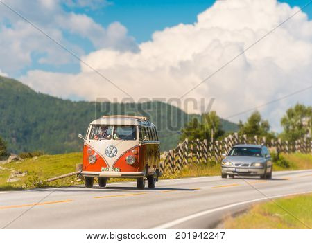Lom Norway - July 25 2013: old VW red and white camper van car on country road in Norway Europe Scandinavia