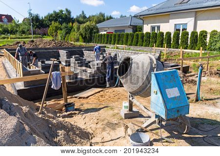 Cement mixer for building house foundation