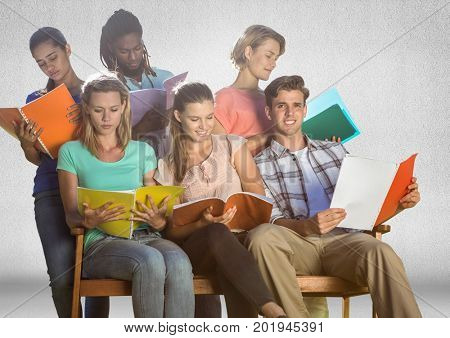 Digital composite of Group of students studying sitting in front of blank grey background