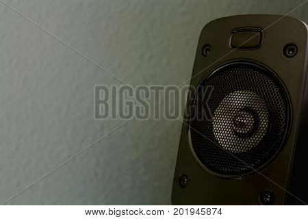 a black speaker on the gray background