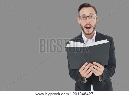 Digital composite of Portrait of Man reading book out loud with grey background