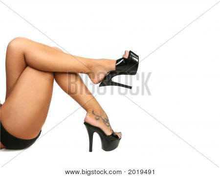 Sleek Sexy Legs With Black Pumps on White poster
