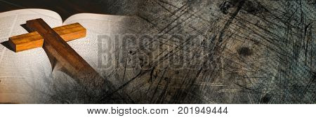 Digital composite of Cross on bible and grunge transition