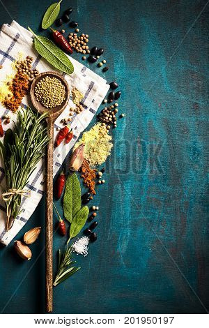 Tasty appetizing indian asian Food Ingredients Spices Flat Lay Wooden Spoon on Turquoise Background Top View Copy Space Above Cooking Healthy Food concept