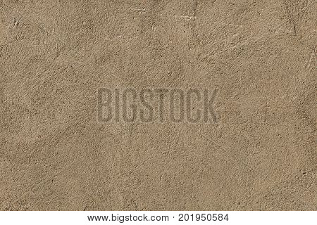 Brown painted stucco wall. Background texture.
