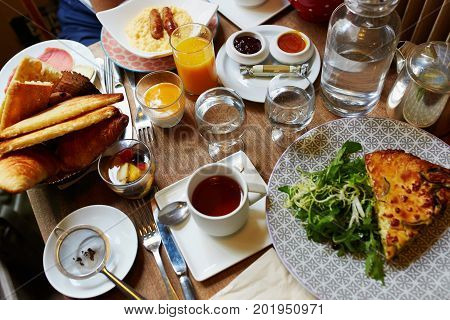 Breakfast Or Brunch With Tea, Coffee, Juice, Eggs And Pastry