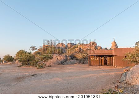 HOADA NAMIBIA - JUNE 27 2017: The reception office at the Hoada Camp in the Kunene Region of Namibia. The swimming pool and bar is on the hill