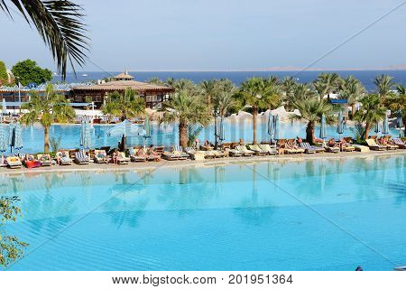 SHARM EL SHEIKH EGYPT - NOVEMBER 30: The tourists are on vacation at popular hotel on November 30 2012 in Sharm el Sheikh Egypt. Up to 12 million tourists have visited Egypt in year 2012.