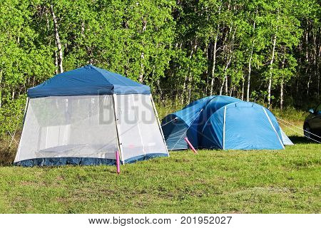 Camping With A Tent And Having A Bug Screen To Retreat To