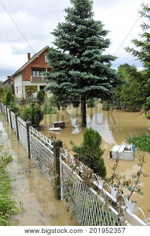 The consequences of flooding, flooded house and yard