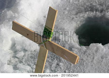 A Homemade Cross Ice Fishing Rod Near A Hole