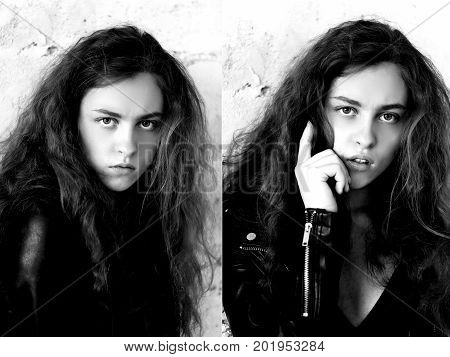Model tests. Beautiful redhead girl with curly hair. Natural color. The bold and the harmful look, a black leather jacket. Against the light brick wall. Studio-loft.