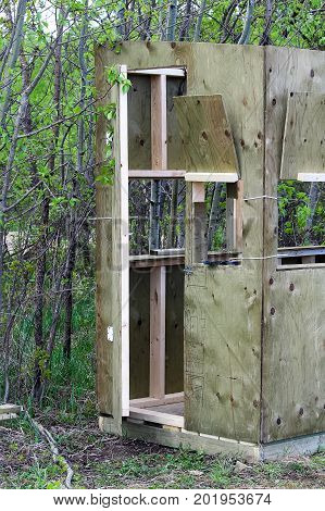 Side view of a hunting blind being assembled.