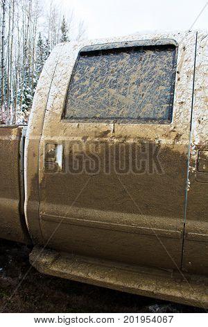 Side Door Of A Truck That Has Been Mud Bogging