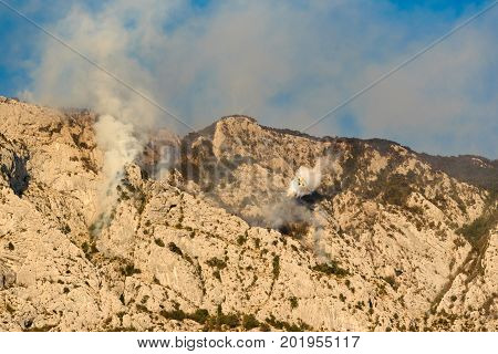 Promajna Biokovo Croatia 24. August 2017 - Firefighting on Biokovo by Canadair CL-415 water bomber amphibious plane near most popular tourist destination Makarska - Middle Dalmatia August 24 2017 in Promajna Croatia