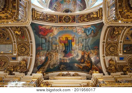 ST PETERSBURG RUSSIA - AUGUST 15 2017. Ceiling decorated with Bible paintings in the interior of the St Isaac Cathedral in St Petersburg Russia