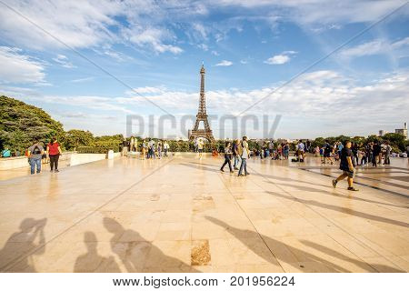 PARIS, FRANCE - August 02, 2017: View on Trocadero square crowded with tourists and Eiffel tower on the background. This place is one of the most popular among the tourists in Paris