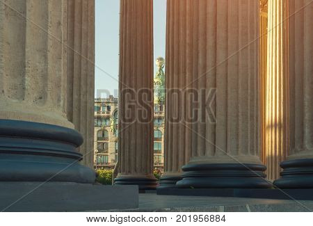 Architecture background of Sr petersburg Russia. Kazan Cathedral colonnade and Zinger House between the columns in St Petersburg Russia