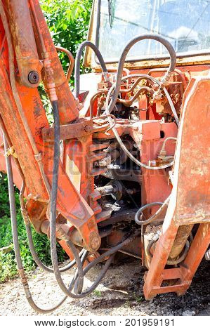 Hydraulic piston system for bulldozers tractors excavators chrome plated cylinder shaft of yellow machine construction heavy industry detail selective focus