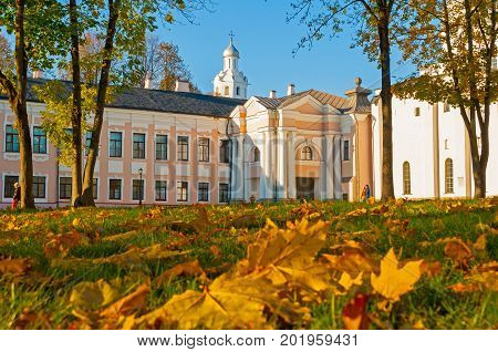 VELIKY NOVGOROD RUSSIA- OCTOBER 9 2016. Veliky Novgorod Kremlin park with Clock Tower of St Sophia Cathedral and fallen autumn leaves on the foreground in Veliky Novgorod Russia