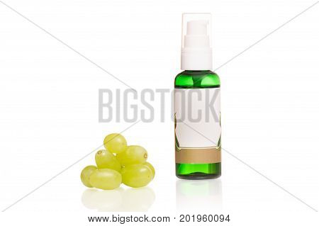 Grapes bones oil cosmetics on a white background isolation