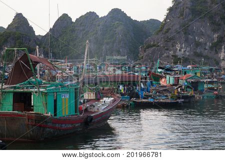HAIPHONG, VIETNAM - AUGUST 2017: Floating village in Cat Ba islands. Cat Ba is the largest of the 366 islands, which make up the southeastern edge of Ha Long Bay in Northern Vietnam.