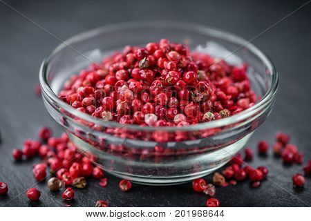 Portion Of Pink Peppercorns On A Slate Slab