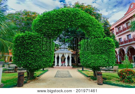 Cayo Coco island, Cuba, Colonial hotel, July 16, 2017, stunning gorgeous amazing view of Colonial hotel grounds, beautiful inviting hotel entrance through decorative stylish bushes gates toward gazebo